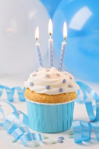 Blue cup cake with birthday candles