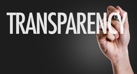 Hand writing the text: Transparency
